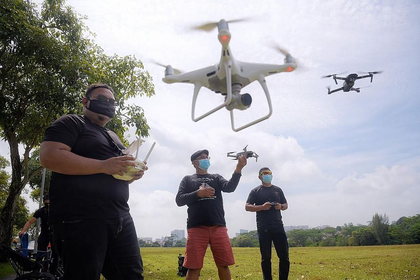 """People flying their drones at an open field in Old Holland Road. An unmanned aircraft systems advisory panel said in its report that the setting up of common drone-flying spaces will enable recreational drone users to gather and """"foster a culture of"""