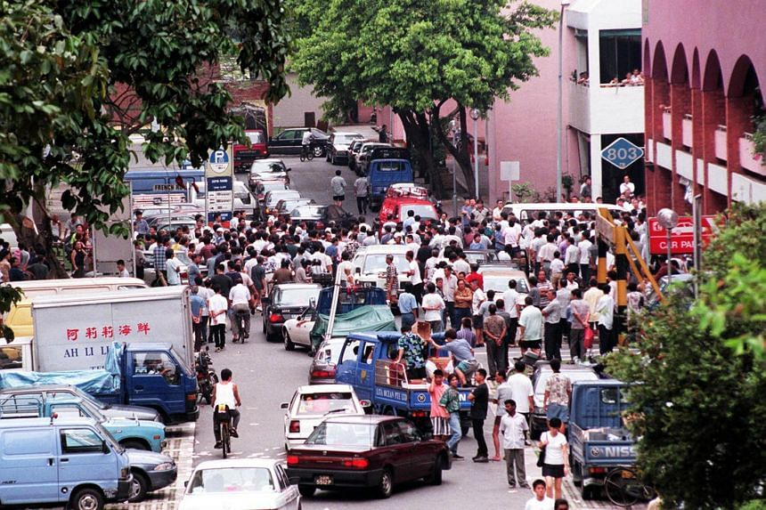 Aw Teck Boon's funeral was attended by scores of people and dozens of policemen.