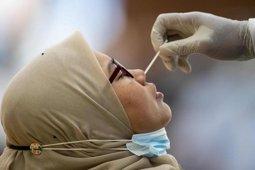 A woman getting her sample taken at a Covid-19 testing centre in Petaling Jaya on Jan 18, 2021.