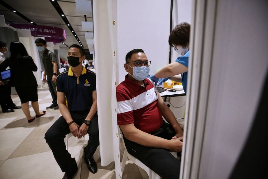 Air crew and front-line airport workers receive their Covid-19 vaccinations at Changi Airport Terminal 4 on Jan 18, 2021.