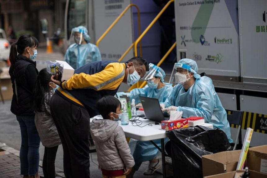 People registering for Covid-19 tests at a mobile testing station in Hong Kong on Jan 17, 2021.