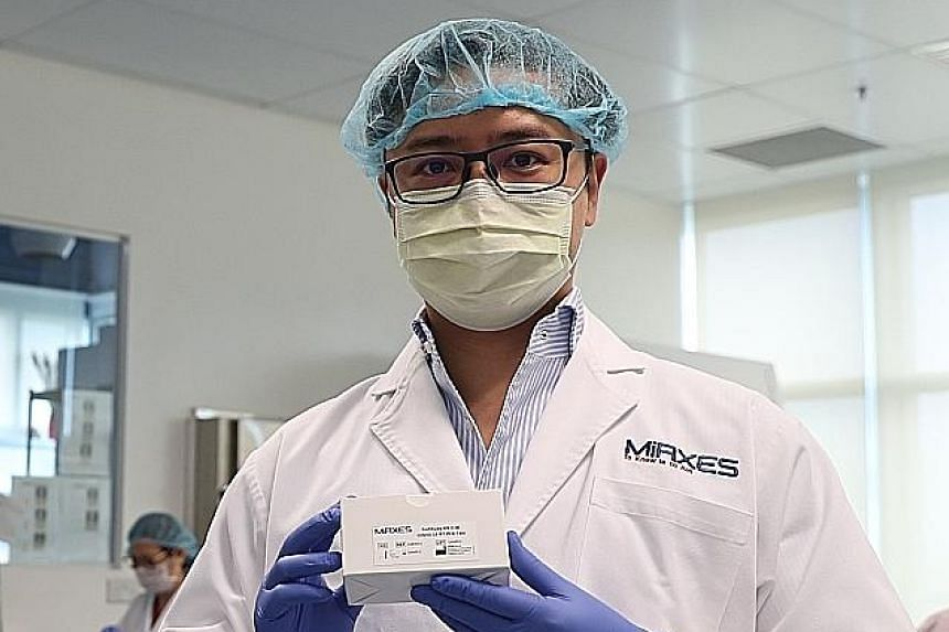 Dr Zhou Lihan, co-founder and chief executive officer of MiRXES, a local molecular diagnostic company that developed the new test kit together with A*Star and Tan Tock Seng Hospital.