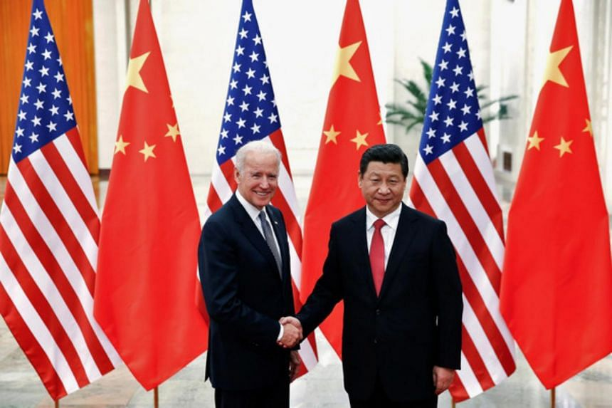 Mr Xi Jinping (right) with Mr Joe Biden in Beijing on Dec 4, 2013.