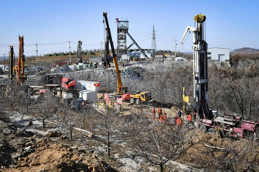 Cranes and a massive bore-hole drill was used to dig new rescue channels to reach the trapped miners.
