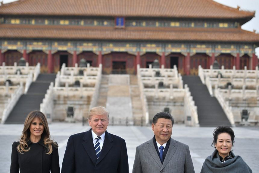 (From left) US President Donald Trump, First Lady Melania Trump, China's President Xi Jinping and his wife Peng Liyuan at the Forbidden City in Beijing, on Nov 8, 2017.