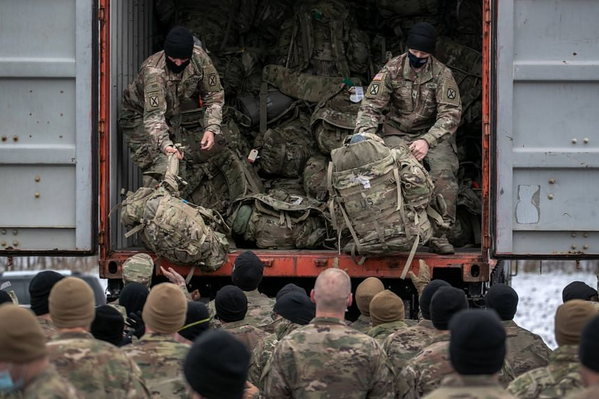 US Army soldiers retrieve their duffel bags after they returned home from a 9-month deployment to Afghanistan on Dec 10, 2020.