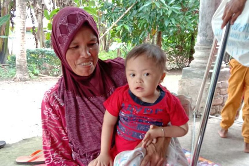Ms Eva Murni and her three-year-old son Muhammad Rahman Naldi, who is stunted. After years of progress in curbing the scourge, Indonesia faces a resurgence of the health problem because of the Covid-19 pandemic.