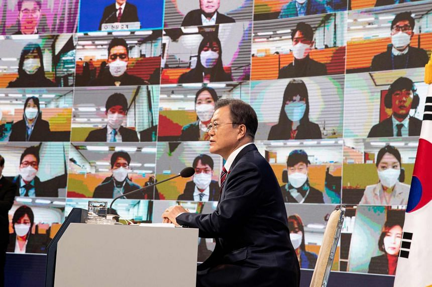 President Moon Jae-in at his New Year press conference in Seoul yesterday. He said South Korea will probably achieve Covid-19 herd immunity quicker than its neighbours.