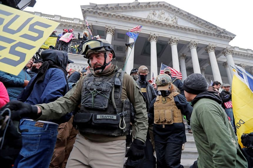 Members of the Oath Keepers are seen among Trump supporters protesting in Washington on Jan 6, 2021.