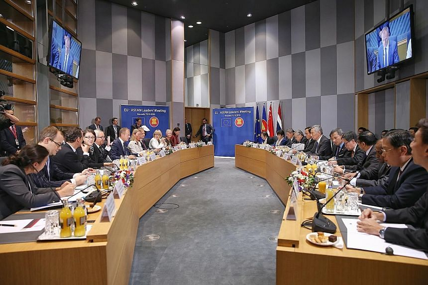 Prime Minister Lee Hsien Loong (seventh from right) and Foreign Minister Vivian Balakrishnan (sixth from right) with European and Asean leaders at the Asia-Europe Meeting in Brussels in 2018. A panellist at yesterday's Singapore Perspectives conferen