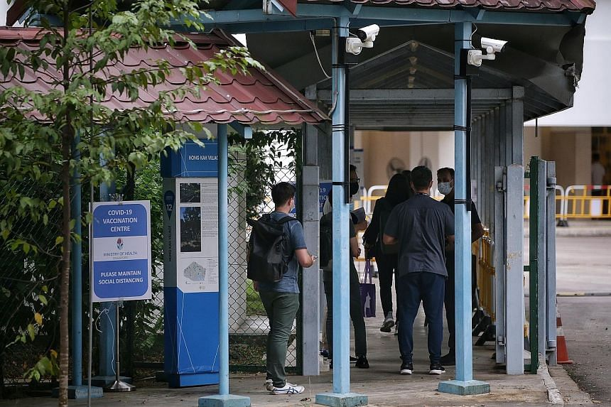 Front-line workers entering the former Hong Kah Secondary School, which is now being used as a Covid-19 vaccination centre, yesterday. Cleaners and nurses were among those who received the jabs. The Health Ministry tender for new centres comes as vac