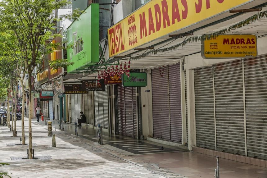Shuttered shops are seen in Kuala Lumpur on Jan 13, 2021.