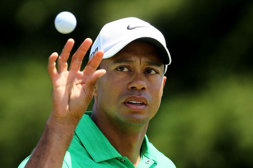 The recent microdiscectomy was 45-year-old Woods' fifth back surgery.