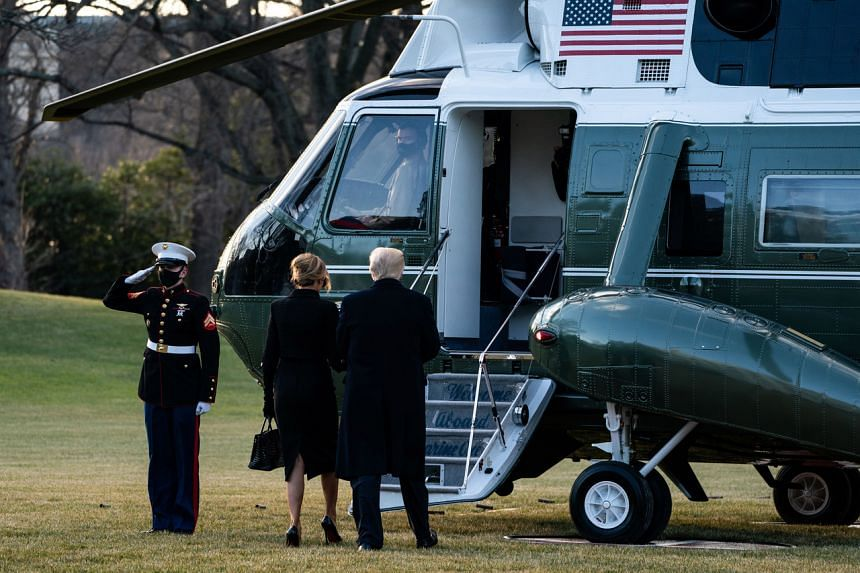 US President Donald Trump and First Lady Melania board the Marine One helicopter as they depart the White House on Jan 20, 2021.
