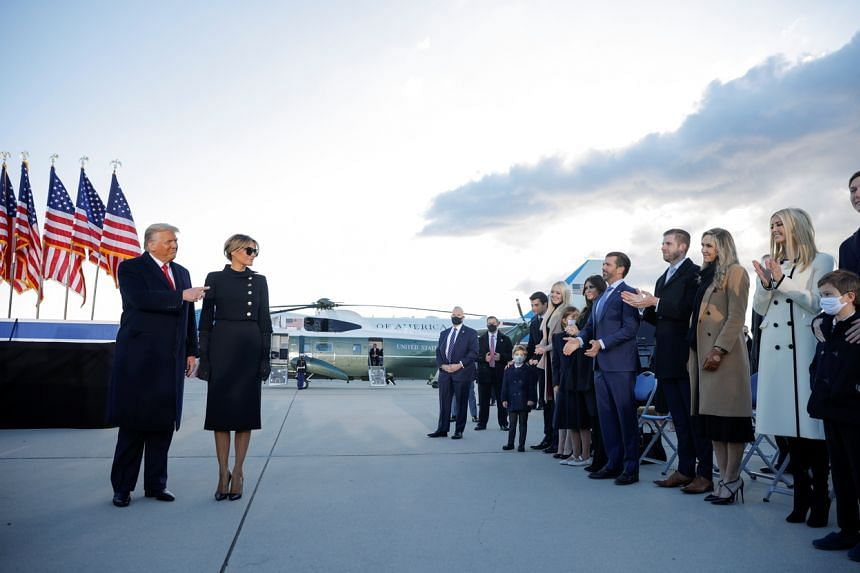 US President Donald Trump and First Lady Melania greet their family members at Joint Base Andrews in Maryland on Jan 20, 2021.