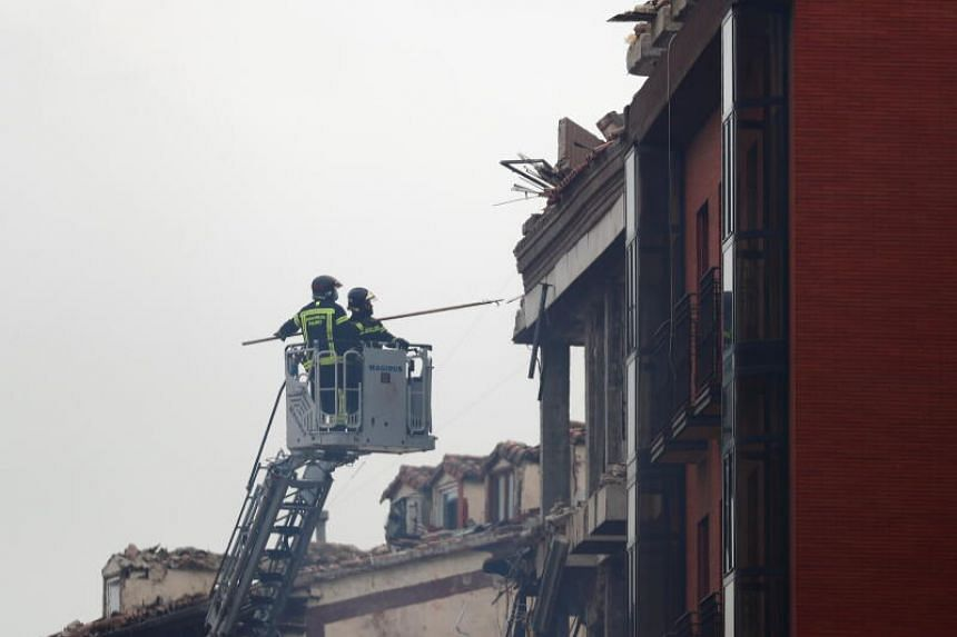Fire fighters carrying out rescue work after an explosion in Madrid downtown, Spain, on Jan 20, 2021.