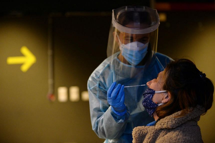 A healthcare worker administers a Covid-19 test in Brussels on Jan 14, 2021.