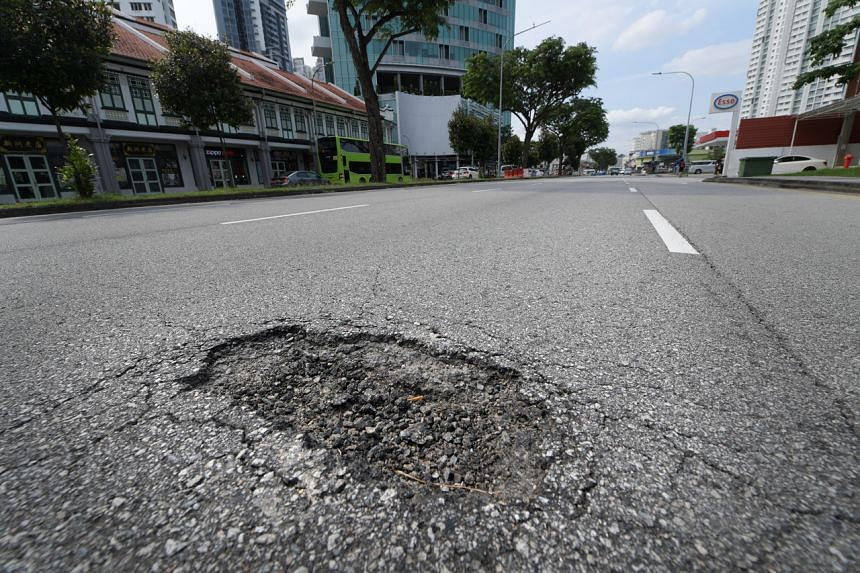 A pothole is seen at Lavender Street on Jan 15, 2021.