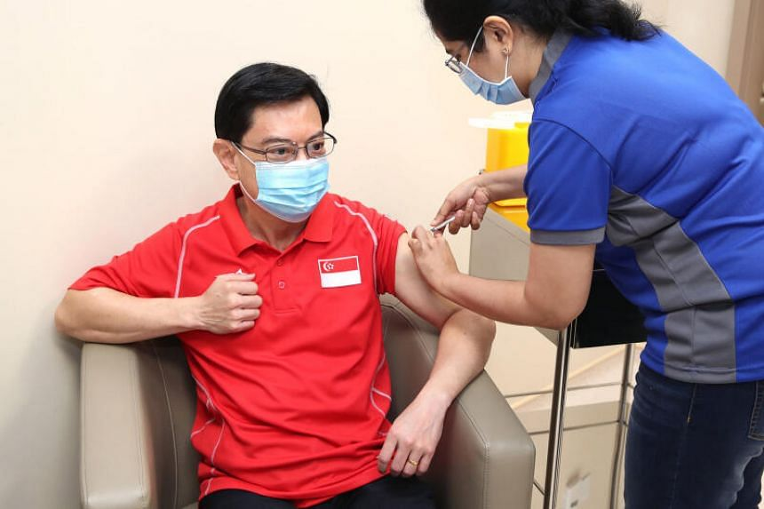 DPM Heng Swee Keat receives his first dose of  Pfizer-BioNTech Covid-19 vaccine from Nurse Manager Imrana Banu on Jan 20, 2021.