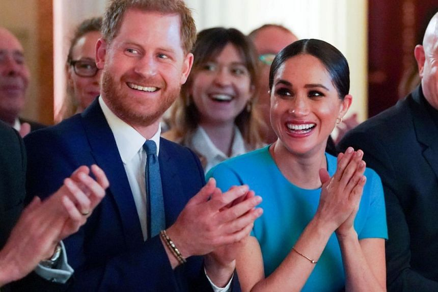 A March 2020 photo shows Britain's Prince Harry and his wife Meghan during an event in London.