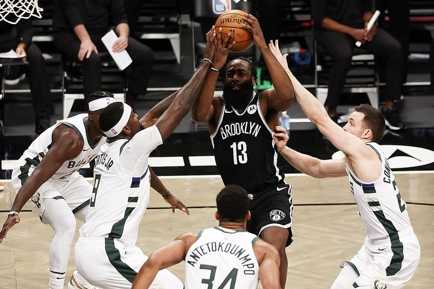 Brooklyn guard James Harden is surrounded by the Milwaukee defence as he drives to the basket in their NBA game at the Barclays Centre on Monday. He had 34 points and 12 assists in the 125-123 win. Keeping his star trio of Harden, Kevin Durant and Ky