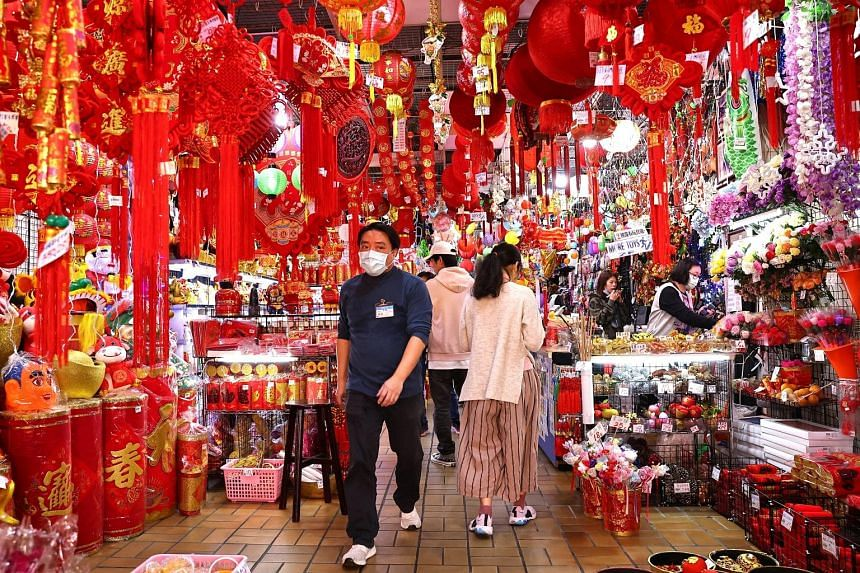 People shopping ahead of Chinese New Year in Taipei yesterday. Taiwan has been praised for its pandemic response, but a rare outbreak of Covid-19 infections connected to a hospital last week has caused alarm. PHOTO: REUTERS