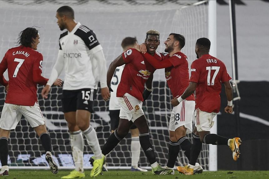 A 2-1 win at Fulham took Manchester United back to the top of the Premier League.