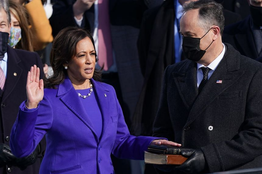 Ms Kamala Harris, flanked by husband Doug Emhoff, is sworn in as Vice-President of the United States, on Jan 20, 2021.