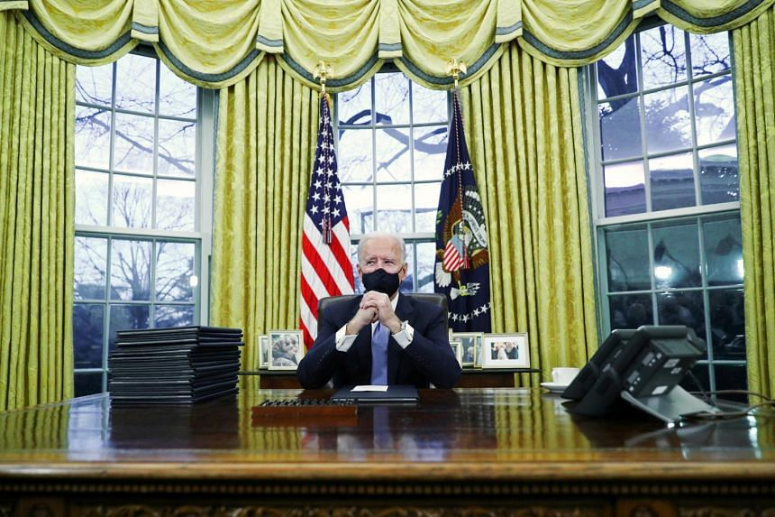 US President Joe Biden in the Oval Office of the White House in Washington on Jan 20, 2021.