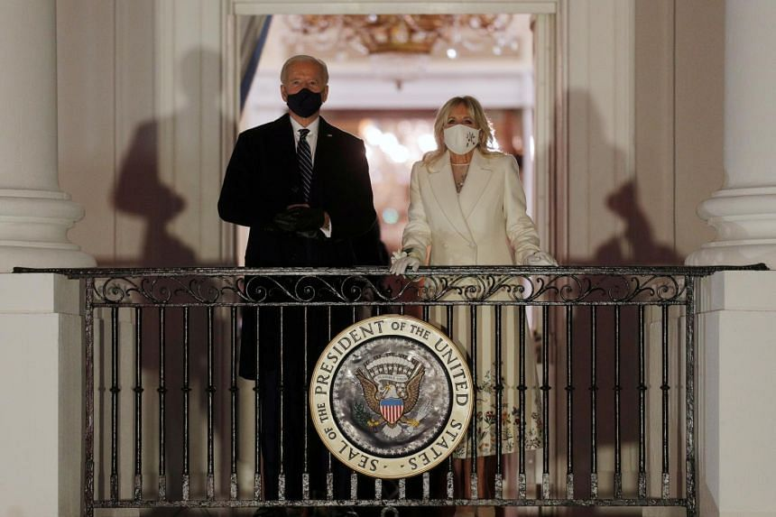 US President Joe Biden and First Lady Jill Biden watch fireworks from the balcony of the White House in Washington on Jan 20, 2021.