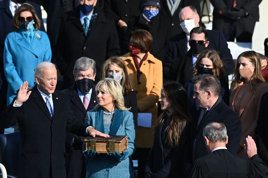 US President Joe Biden takes the oath of office during the swearing-in ceremony on Jan 20, 2021.
