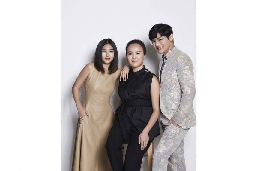 Harper's Bazaar editor-in-chief Kenneth Goh (above, right) with designers Rena Kok (left) and Silvia Teh (centre), both past winners of the annual Harper's Bazaar Asia NewGen Fashion Award.