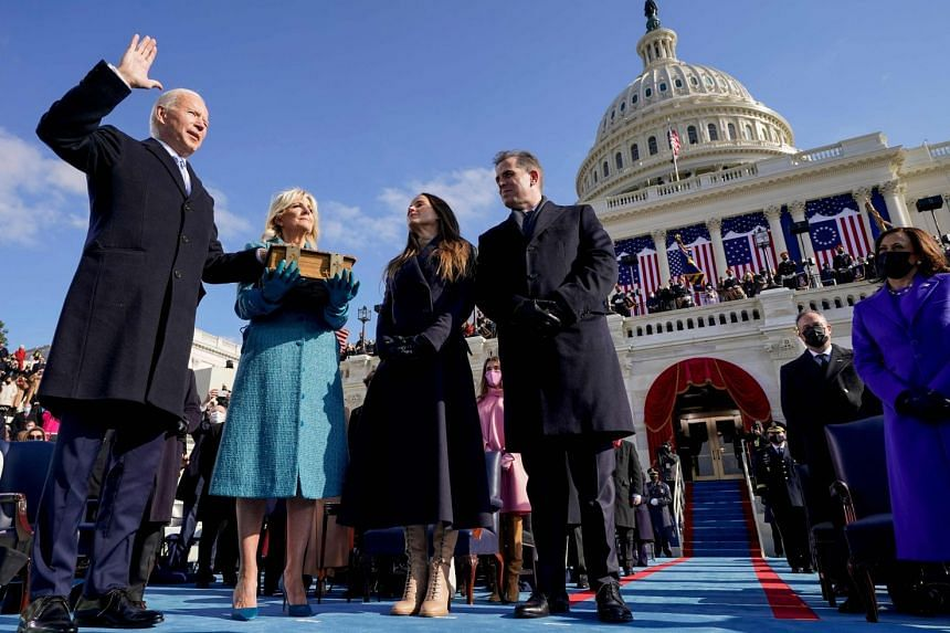 Mr Joe Biden (left) is sworn in, with his family by his side, on Jan 20, 2021.