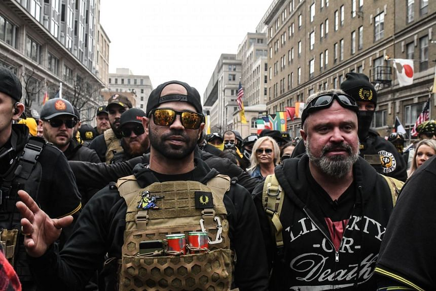 Proud Boys leader Enrique Tarrio (left) and Joe Biggs (right) are pictured in Washington during a protest on Dec 12, 2020.