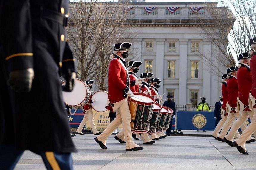 The inaugural parade is seen as US President Joe Biden and Vice-President Kamala Harris head to the White House in Washington on Jan 20, 2021.