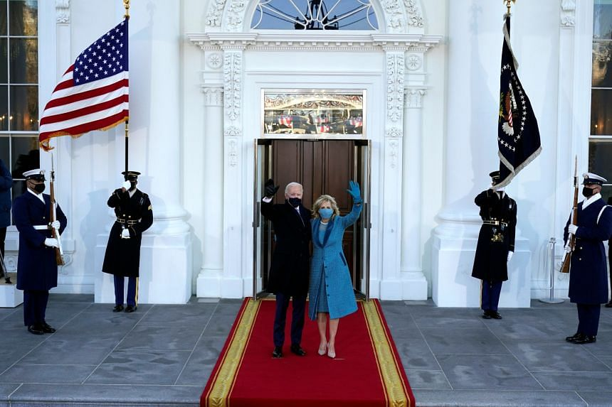 US President Joe Biden and first lady Jill Biden wave as they arrive at the North Portico of the White House, in Jan 20, 2021.
