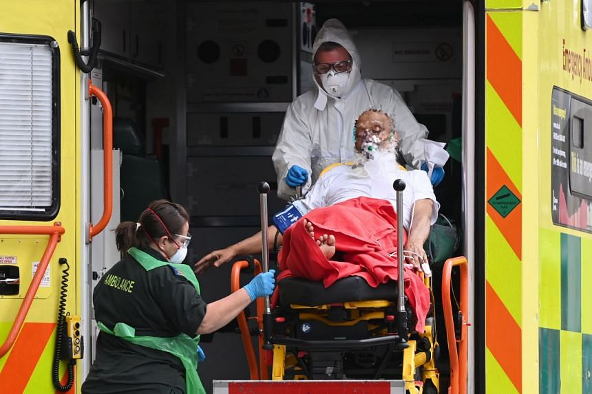 A patient is brought into the Royal London hospital in London, Jan 21, 2021.