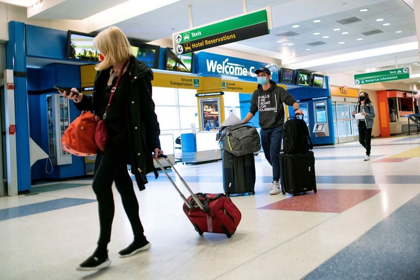 A December 2020 photo shows passengers arriving from London at JFK International Airport in New York City.