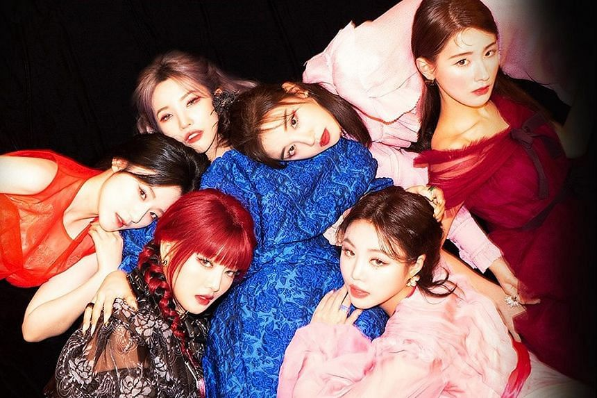 (G)I-dle (above).