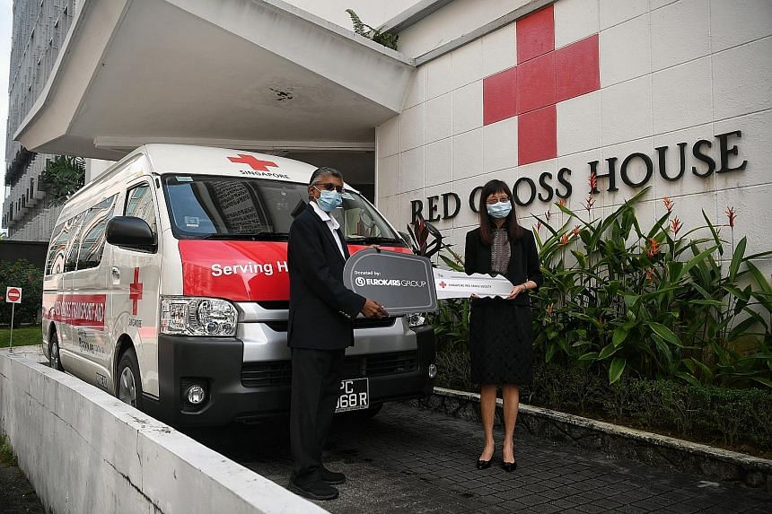 Singapore Red Cross chief executive and general secretary Benjamin William and Eurokars Group managing director Ong Lay Ling at the handover ceremony at Red Cross House on Wednesday.