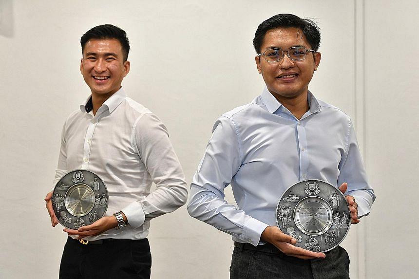 Mr Clement Tan (far left) and Mr Muhammad Mu'tasim Kassim helped to subdue a passenger who was assaulting a bus driver in September last year.