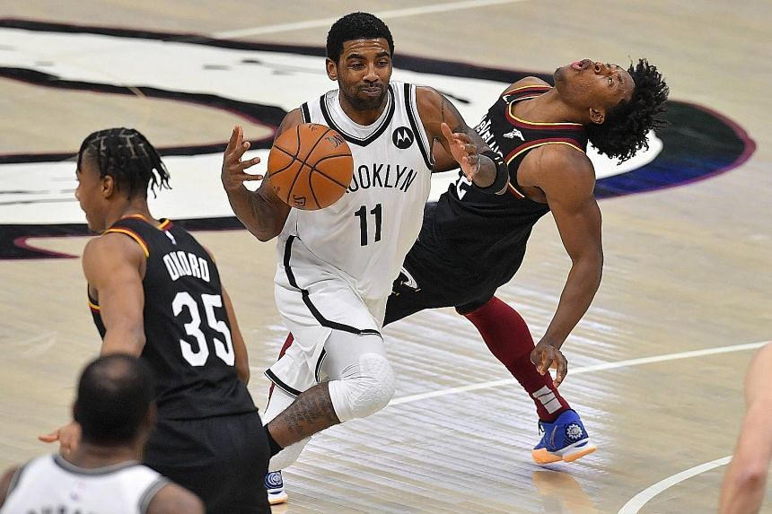 Kyrie Irving running into Cleveland's Collin Sexton. Sexton's three-pointer forced a second overtime, when he scored 15 of his career-high 42 points.