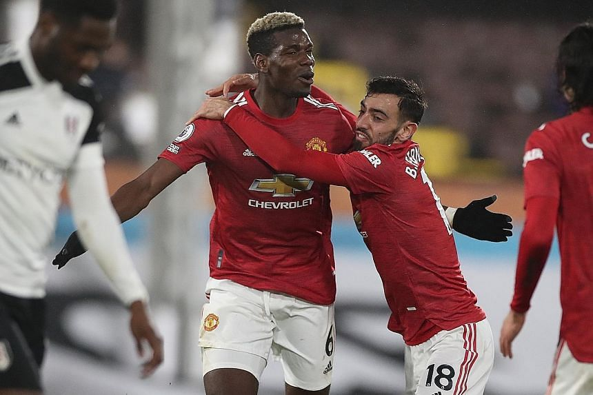 Manchester United's Paul Pogba (far left) celebrating his winner with fellow midfielder Bruno Fernandes in their 2-1 Premier League win over Fulham on Wednesday. The victory meant that the Red Devils are back on top of the table, two points ahead of