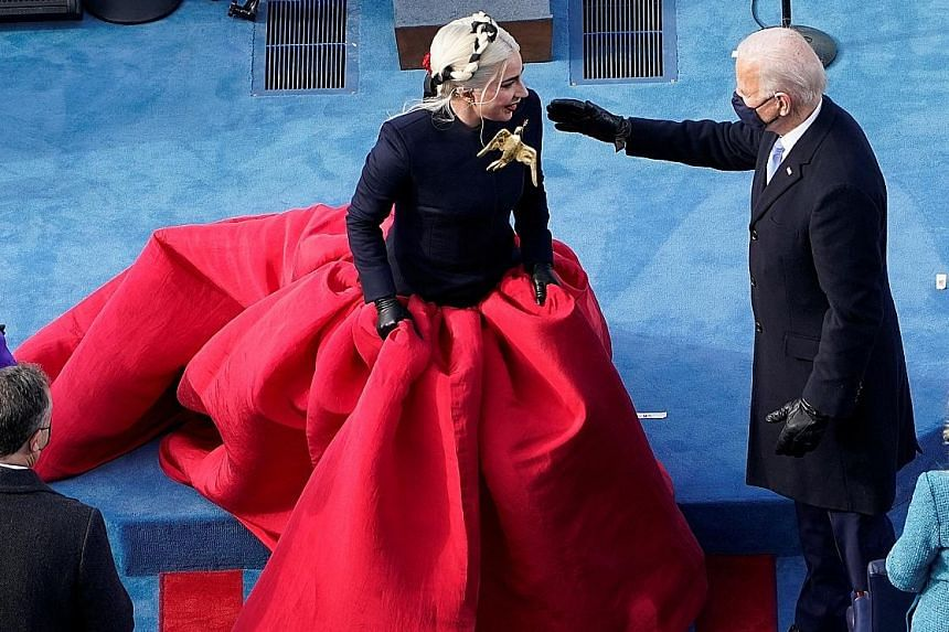 President Joe Biden greeting Lady Gaga during the 59th Presidential Inauguration on Wednesday. Jennifer Lopez arriving at the inauguration ceremony on Wednesday.