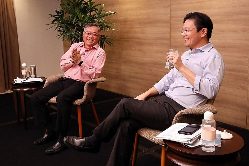 Health Minister Gan Kim Yong and Education Minister Lawrence Wong, who co-chair the Covid-19 task force, at a media conference on Tuesday to mark one year of the Covid-19 battle in Singapore. PHOTO: LIANHE ZAOBAO