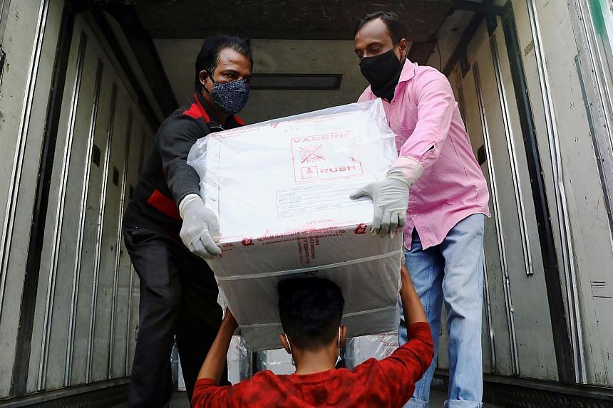 Workers in Dhaka unloading AstraZeneca Covid-19 vaccines which had arrived from India as a gift to Bangladesh yesterday. Covax, a global scheme co-led by the World Health Organisation, wants to deliver at least two billion Covid-19 vaccine doses acro
