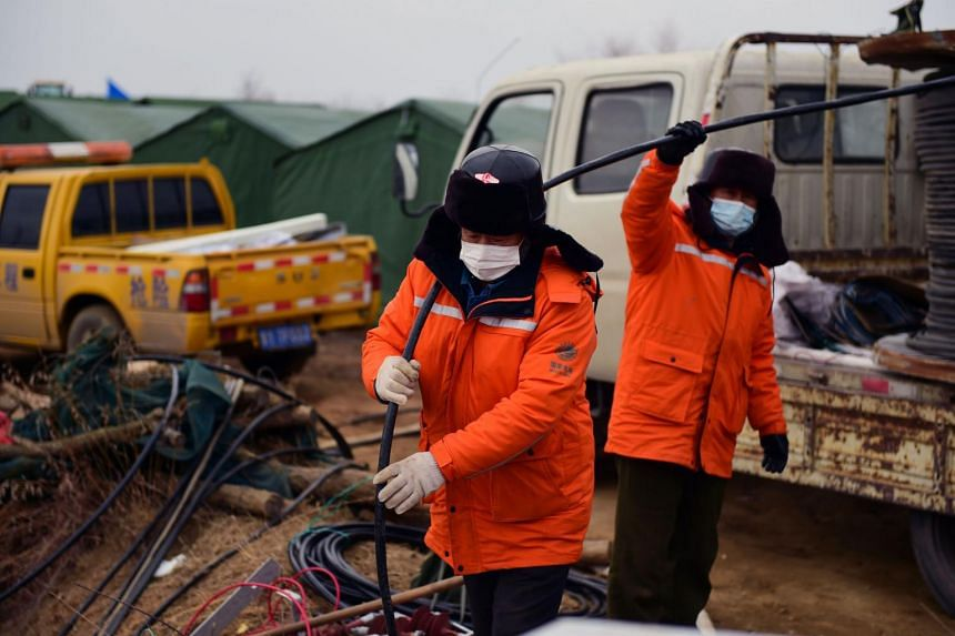 Members of a rescue team working at the site of the gold mine explosion in Shandong, on Jan 20, 2021.
