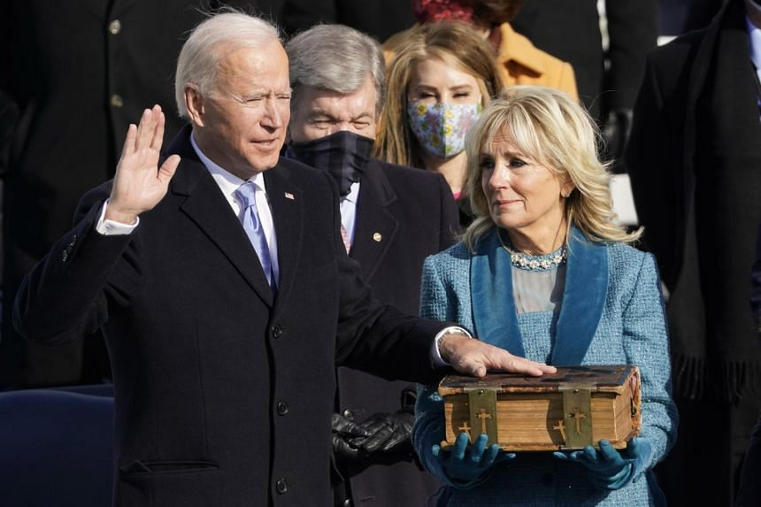 President Joe Biden taking the oath of office on Jan 20 with his left hand on a colossal 19th-century family Bible held by his wife, Jill.