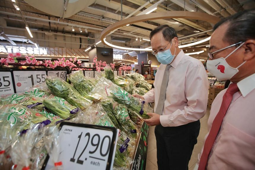 Second Minister for Trade and Industry Tan See Leng and FairPrice Group chief executive Seah Kian Peng at the new FairPrice Xtra hypermarket at Parkway Parade on Jan 22, 2021.