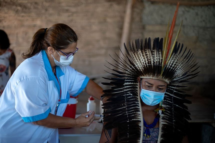 The chief of an indigenous tribe in Brazil getting a dose of the Covid-19 vaccine made by China's Sinovac Biotech at a tribe camp in Rio de Janeiro on Wednesday.